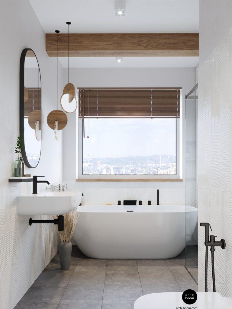 łazienka biała z wanną wolnostojącą pod oknem